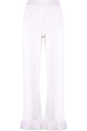 Alanui Fringed flared trousers