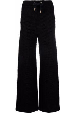 Balmain Quilted-monogram sweatpants