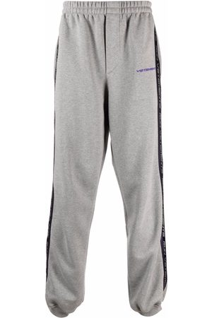 Vetements Logo tape track pants - Grey