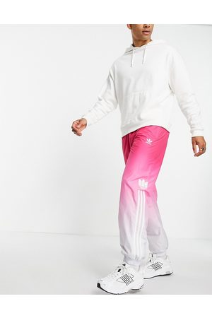 adidas 3D trefoil ombre track pant in magenta
