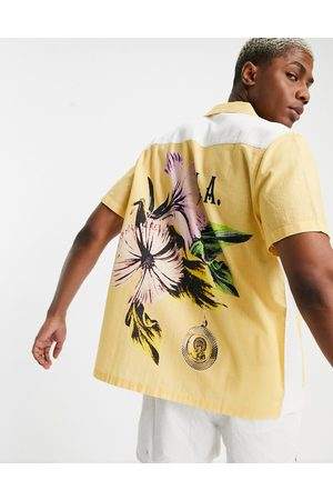 ASOS Relaxed revere shirt with patchwork back placement floral