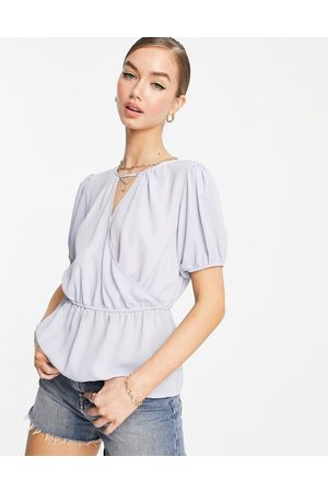 ASOS Women Wrap tops - Wrap front blouse with peplum hem and puff sleeves in light blue-Blues
