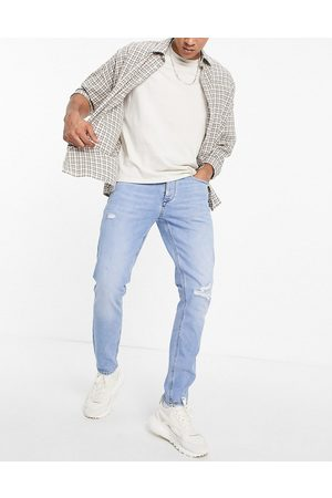 River Island Slim jeans with rips in light blue-Blues