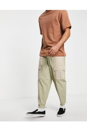 ASOS Oversized tapered pants with contrast laid on panels-Neutral