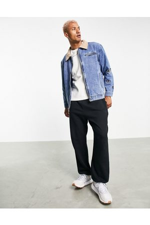 Mennace Worker denim jacket set in with contrast suede collar and butterfly embroidery-Blues