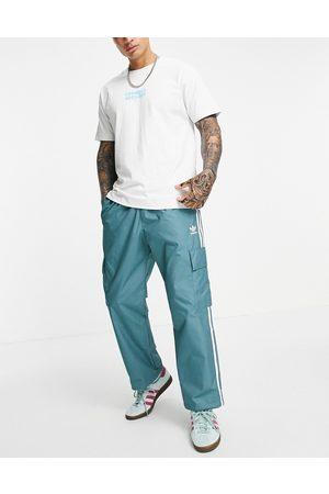 adidas Adicolor three stripe cargo pants in emerald