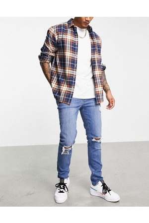 ASOS Skinny jeans in mid wash blue with knee rips-Blues