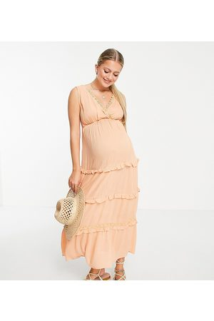 ASOS ASOS DESIGN Maternity sleeveless tiered crinkle maxi dress with lace inserts in peach