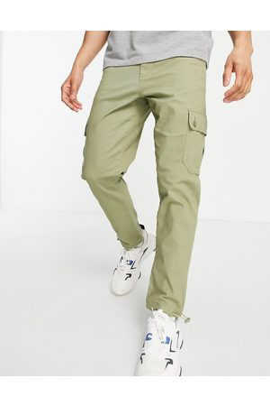 ASOS Tapered cargo pants in light with toggles