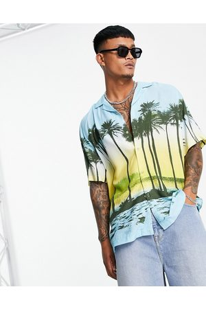 ASOS Relaxed fit longline shirt in tropical scenic print