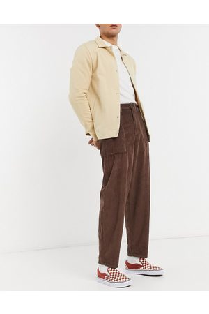 ASOS Men Chinos - Chunky corduroy pants with balloon fit in
