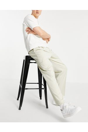 ASOS DESIGN Oversized tapered cargo pants in stone-Neutral