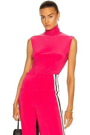 Norma Kamali Slim Fit Sleeveless Turtleneck Top in