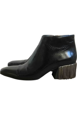 Acne Studios Patent leather western boots
