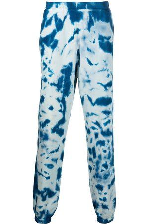 The Elder Statesman Tie-dye cotton track trousers