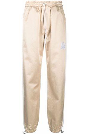 AMIRI Side-stripe logo track pants - Neutrals