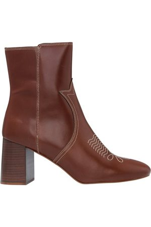 See By Chloe Lizzi Western boots
