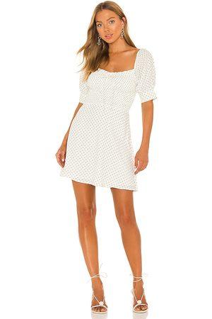 FAITHFULL THE BRAND Dulcia Mini Dress in White.