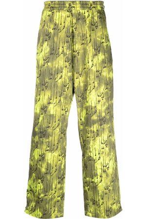 Paria Farzaneh Sweatpants - Neon-print side-zip trousers