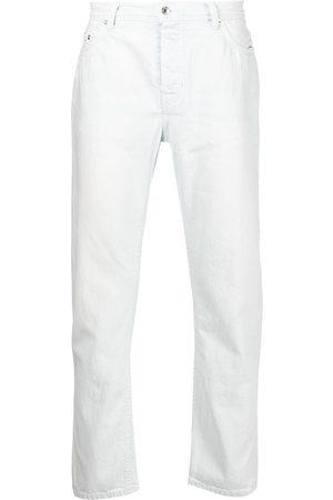Enfants Riches Déprimés Bleach-wash tapered-leg jeans