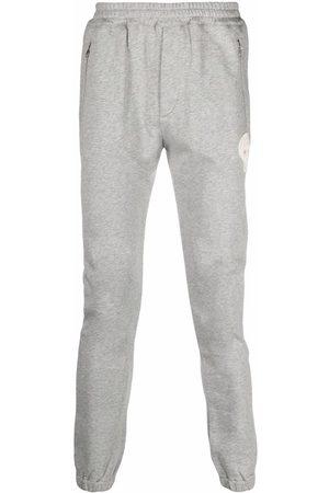Alexander McQueen Skull-patch track pants - Grey