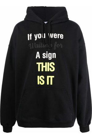 Vetements Oversized slogan-print hoodie