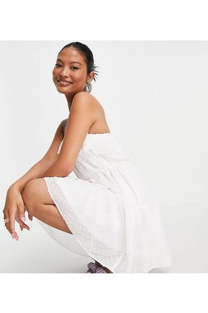 ASOS ASOS DESIGN Petite ruffle bandeau mini skater dress with belt in textured in ivory