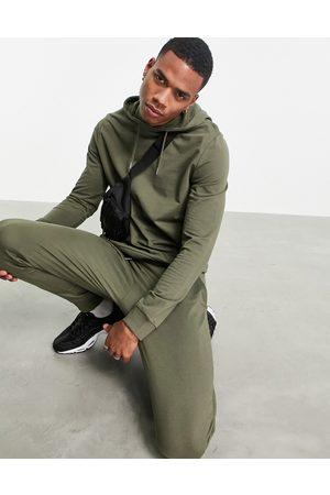 ASOS DESIGN Organic lightweight tracksuit with hoodie & skinny sweatpants in