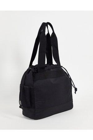ASOS Oversized tote bag in nylon with multi pockets