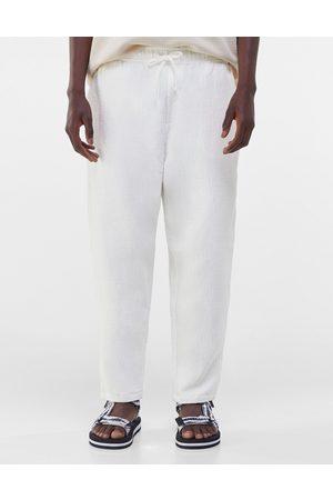 Bershka Loose fit textured pants in ecru-Neutral