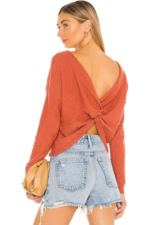 Steve Madden Twist Connection Sweater in Rust.