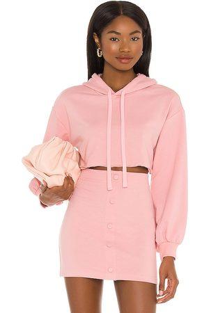 Camila Coelho Laurell Crop Hoodie in Pink.