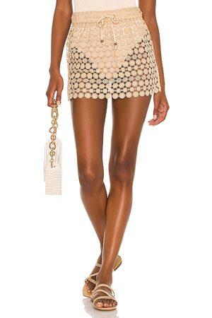 Lovers + Friends Chiara Mini Skirt in Tan.