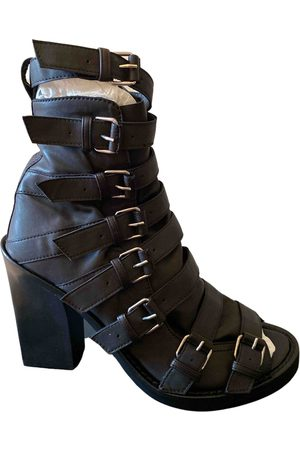 ANN DEMEULEMEESTER Leather buckled boots