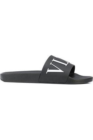 VALENTINO GARAVANI Men Sandals - Logo-print slides