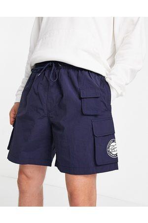 Tommy Hilfiger Men Shorts - Nylon cargo beach shorts in navy