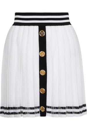 Balmain Pleated monogram knit miniskirt