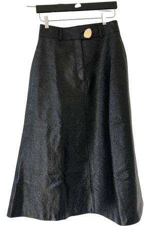 A.W.A.K.E Women Leather Skirts - Patent leather mid-length skirt