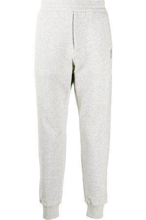 Alexander McQueen Men Sweatpants - Skull patch track trousers - Grey