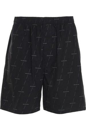 Balenciaga All Over Logo Shorts