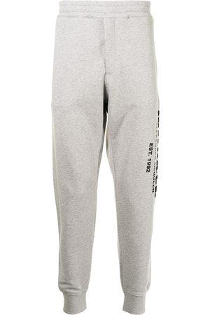 Alexander McQueen Men Sweats - Graffiti Logo Sweatpants Grey