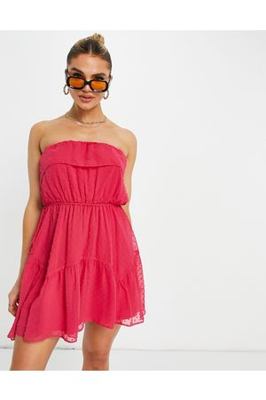 ASOS DESIGN Ruffle bandeau mini skate dress with belt in textured hot