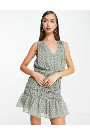 ASOS DESIGN Soft sleeveless mini dress with ruched skirt in textured khaki