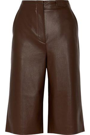 Nanushka Tazu dark longline faux leather shorts