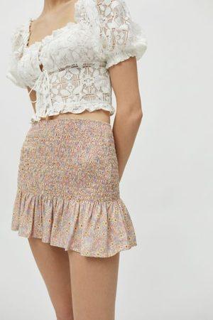 Motel Rylee Smocked Mini Skirt