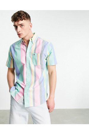 Tommy Hilfiger Pastel capsule flag logo varied stripe short sleeve shirt in romantic