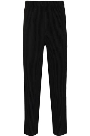 Homme Plissé Issey Miyake Pleated tapered high-waisted trousers