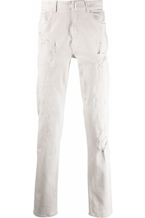 Givenchy Distressed-effect slim-fit jeans