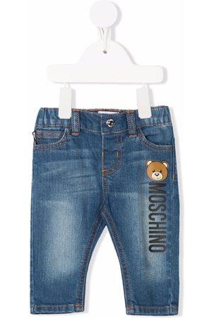 Moschino Kids Mid-wash logo-print jeans
