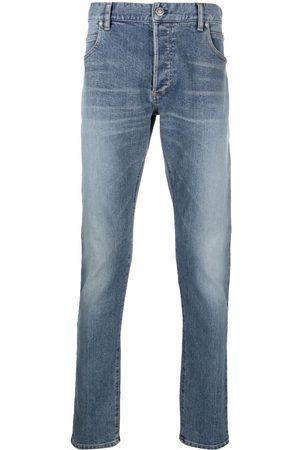 Balmain Embossed logo slim-fit jeans